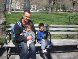 Dad and sons sitting on bench
