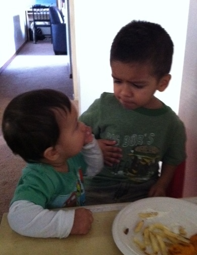 little brother steals big brother food
