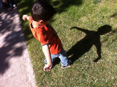 little boy sees his shadow