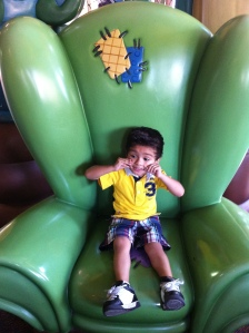 Little boy sitting on chair