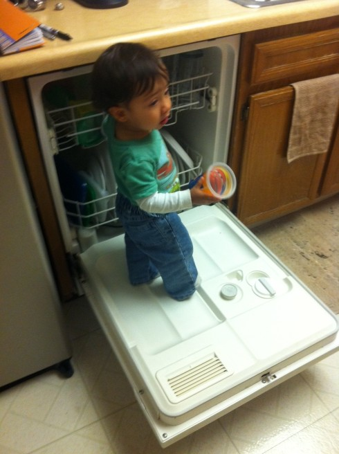 Baby in kitchen being wild