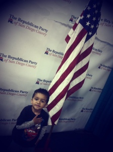 Boy next to USA flag