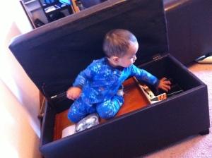 little boy inside ottoman