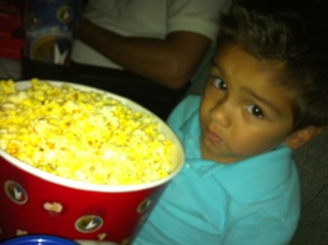 little boy with popcorn