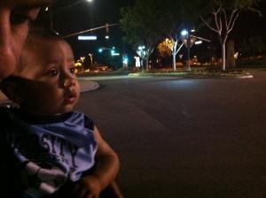 little boy looks on