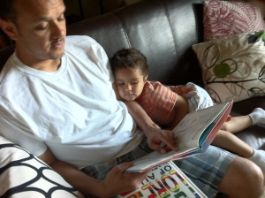 daddy reading to son