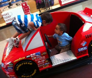 kids playing on a race car