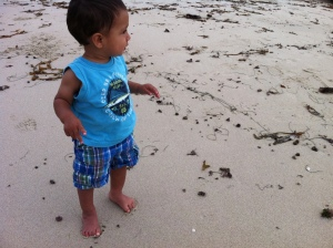 little boy on beach sand